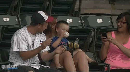 This dad who saves his son from throwing away a prize game ball he was just handed. | 11 GIFs That Prove Dads Are Superheroes