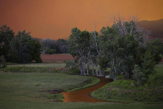 The sky turns a brilliant orange as smoke from the High Park Fire fills the sky near Laporte, Colo.