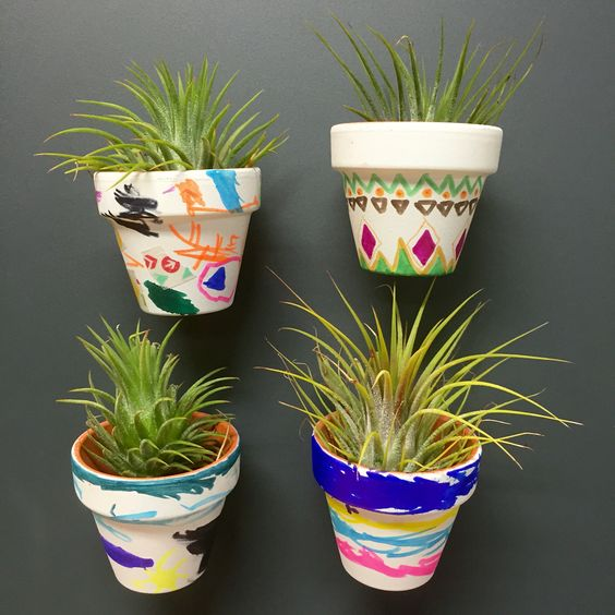 Wee Warhols decorated these tiny pots today.  We hot glued magnets to them and added air plants. Kids crafts art classes Austin.