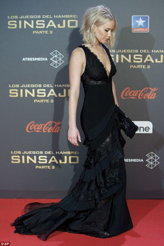 Easy does it: Jennifer watched her step as she carefully made her way down the red carpet...