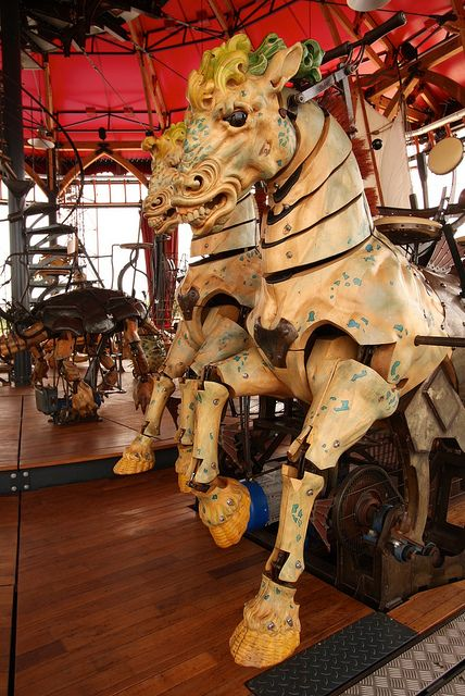 Jointed Mechanical Horse at the Carousel des Mondes Marins in Nantes, France. This carousel (25 meters high, 20 meters in diameter) is an incredible sculpture dedicated to the sea The carousel, created by Pierre Orefice and François Delarozière, is guarded by 16 fishermen from all the world's oceans.: