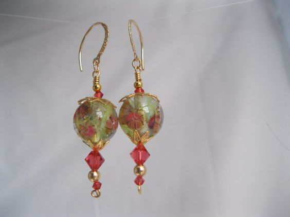 Peach and light green lamp work earrings with gold wires