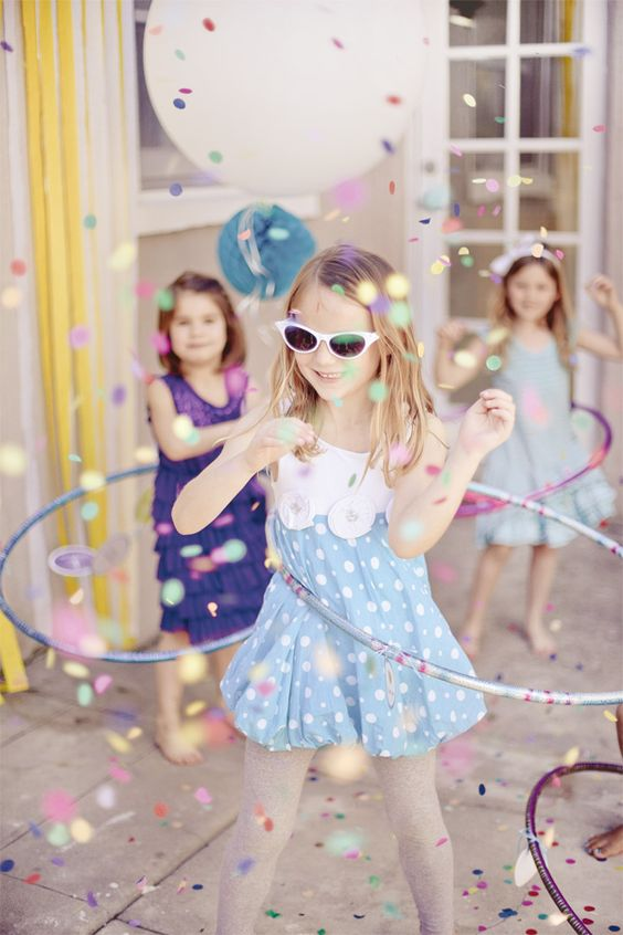 Little girl party... Confetti hula hoops and kiddie DIY photo booth!