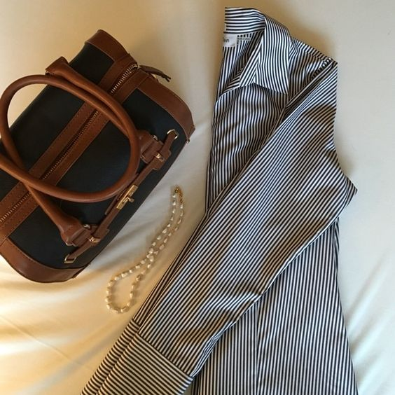 Calvin Klein Striped Fitted Shirt This shirt is ideal for an office, but unfortunately it's a size too big for me. Navy and white stripes, button up with buttoned cuffs, and it claims not to need ironing (I disagree and ironed it after washing). Worn once!   Pet owner Non-smoker ✔️ Bundles ✖️ Trades ✖️ PayPal Calvin Klein Tops Button Down Shirts