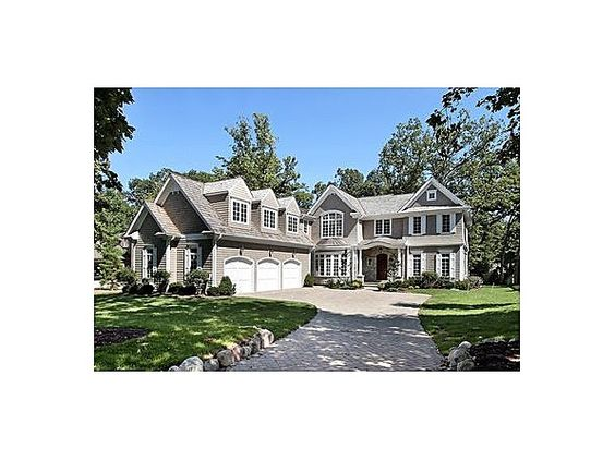 6500 SQ FOOT STONE & CEDAR NEW ENGLAND COLONIAL ON LG LOT IN PRIME LOCAL NEWER CONST FROM AVIS HOMES. GREAT ARCHITECTURAL DETAILS, GRACIOUS MOLDINGS, COFFERED CEILINGS. FEATURES A SPACIOUS OPEN FLR PLAN, W/LG STATE OF THE ART KIT, LR, LIB, FR & SUN RM. DINING ROOM W/ OVERSZ BAY WIND. 5 BR/5 BA ON 2ND LEVEL. BILLARD, EXER SIZE, 2ND FAMILY RM & BR/BA IN LOWER LEVEL. WALK TO TOWN, TRAIN & LAKE. #zillow