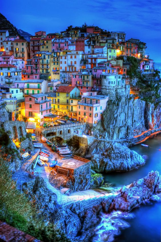 Cinque Terre, Italy - A treasure of Italy that stretches along 18km between La Spezia and Levanto. Consisting of five villages separated by mountains full of olive groves and vineyards.