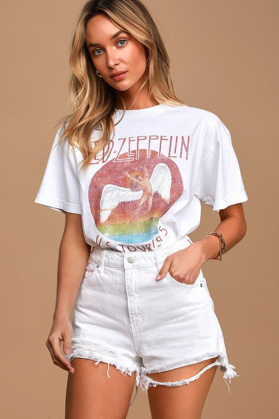 """The Rolla's Dusters White High Waisted Distressed Denim Cutoff Shorts are a sunny day essential! Sturdy white denim (in Rolla's Vintage White Worn wash) shapes these high-waisted shorts that are perfect for tucking tees into. Shredded hems and distressing throughout adds a rough and edgy touch. Belt loops and a five-pocket cut. Branded top button and hidden zip fly. Fit: This garment fits true to size. Length: Above mid-thigh. Size 26 measures 13.75"""" from waist to hem. Waist: Fitted - very fitte"""