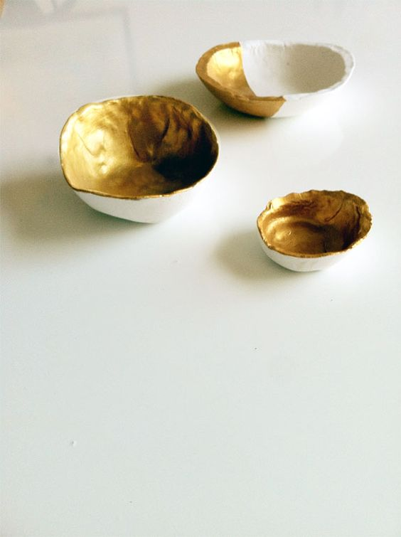 We love @Kate @ Wit + Delight's spin on our gold bowl idea! So pretty. See how to do it here: http://www.curbly.com/users/capreek/posts/13115-how-to-make-a-diy-gold-paint-dipped-faux-porcelain-bowl-from-scratch