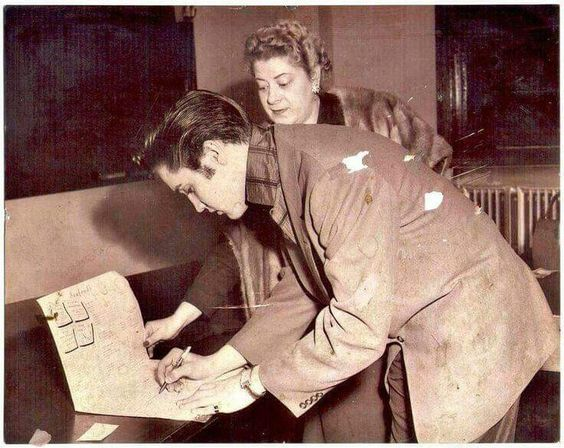 March 27, 1957 - Elvis With Mrs. Herbert 'Margaret' Judd Anterton at the train station in Memphis. - Elvis is on his way to Chicago for the opening show of his first tour of 1957....The menu Elvis is signing for Margret Anterton must be for Anterton's, a Memphis seafood restaurant on 151 Madison Avenue that her husband, Herbert owns. - Ironically, Elvis was never a big fan of things like oysters. ( I know he didn't like the smell of fish cooking either.)