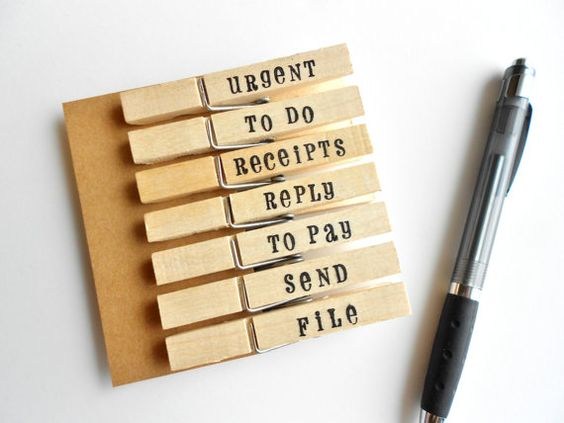 Home Decorating - office/paper organization Stamped organization clothes pins or DIY by labelling wooden clothes pins from dollar store