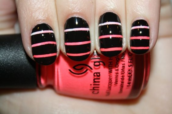 Sponge on fading colors. Put thin strips of tape horizontally on your nails then paint black over it and remove the tape!