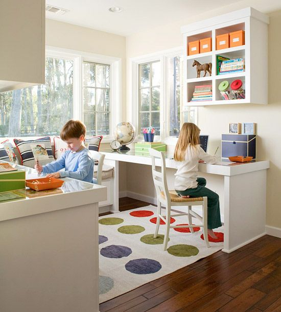 """Idea for a kitchen nook or different use of a formal dining room """"Let your kitchen nook double as a home office by adding slender tables along opposite walls with a cozy couch between. This family-focused wing takes advantage of the room's natural light"""""""