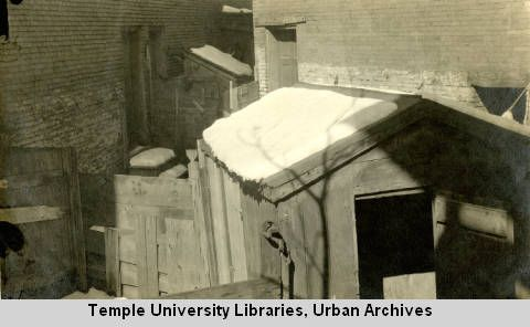 Germantown Avenue, Philadelphia, PA, 28 feb 1917; Privy vaults in the rear of 1009 Germantown Avenue. Snow covers rooftops and ground. ~ Housing Association of the Delaware Valley Photographs