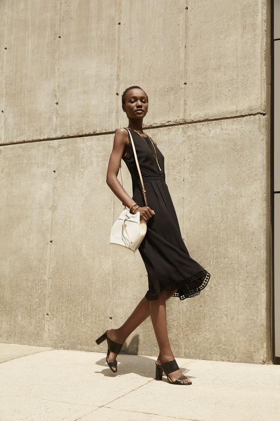 The key to wearing black in summer? Superlight, airy fabrics that beat the heat.
