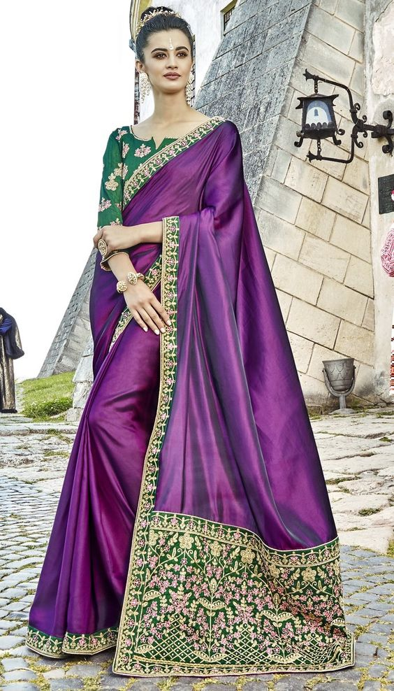 Work Type: Cording & Resham Embroidery with Stones Work Saree Color: Purple Blouse Color: Green Saree Fabric: Satin Silk Blouse Fabric: Art Silk Saree Size: 5.50 Metres Blouse Piece Size: 0.80 Metre Blouse is delivered Unstitched.It can be