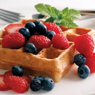EatingWell Waffles -- These healthy waffles are made from a blend of whole-wheat and regular flour plus nonfat buttermilk and canola oil. Top with fresh berries or sliced peaches and yogurt for a satisfying start to any day. @EatingWell
