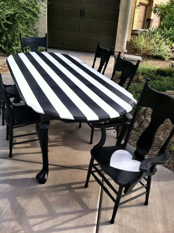 Amazing black and white striped dining table completed by Olivewood Designs....follow them on Facebook.