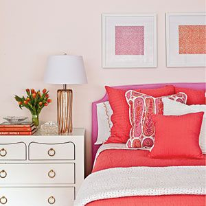 Decorate with Purples and Pinks | Keep the wall paint white and energize the room with bright pink decor, such as bedding and artwork. | SouthernLiving.com