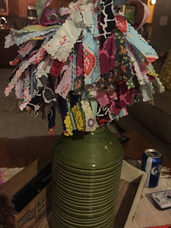 Scrap Buster!  Use pinking shears and cross cross fabric.  Attach to a 1 inch wooden dowel with a wood screw.