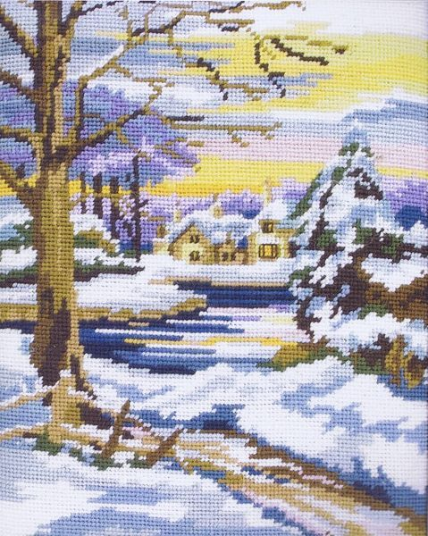 A snowy landscape with a house and trees.