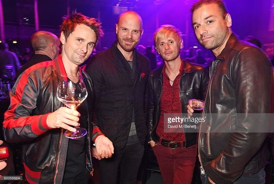 Will Champion of Coldplay (2L) poses with Matt Bellamy, Dominic Howard and Chris Wolstenholme of Muse attend a drinks reception at The Stubhub Q Awards 2016 at The Roundhouse on November 2, 2016 in London, England.: