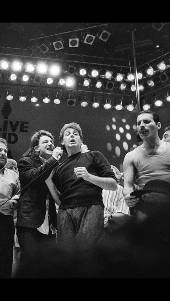 Bono, Paul McCartney & Freddie Mercury together on stage during the Live Aid concert at Wembley Stadium on 13 July, 1985 in London, England.