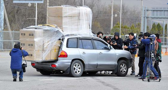 Paju, South Korea, a car filled with workers returning from Kaesong Industrial Park with a load of boxes afterNorth Korean workers failed to show at joint industrial zone.