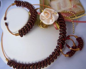 "Copper In Rope Brown Wire Coiled Choker Necklace Set by Tracy Parris  This Set come complete with matching Hoop Earring and Bracelet. Made from Copper dark brown wire and Gold Plated 12 gauge wired to form the neck ring. The Hoop Earrings measures 1.5"" in length and less than 2"" around.   $75.00  On Artful Vision, a portion of your purchase is donated to a participating non-profit of your choice. #bracelet #Brown #necklace"