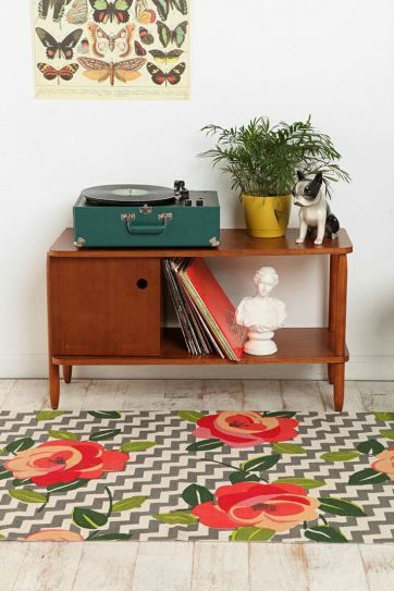 A mix of nature's elements. Butterflies, flowers and a plant. I have a vintage record player and it needs a space to live.: