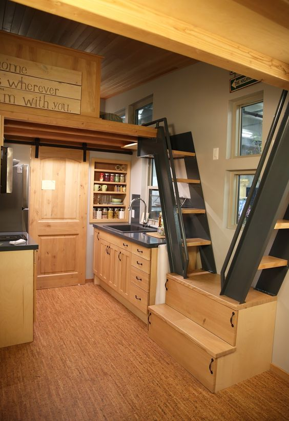When your home is small, you can spend more on high-quality furniture and appliances, like this snazzy kitchen, all dressed up in wood! Get Up Close and Personal with Some of the Swankiest Tiny Homes on the Market - The Accent™   Tiny Homes