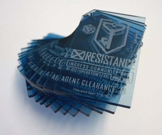 Personalised Ingress Badges, laser engraved from transluscent blue acrylic. ArtisanModelMakers.