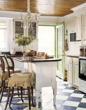 I am loving white kitchens...and the checkerboard floor looks so classic in this space!