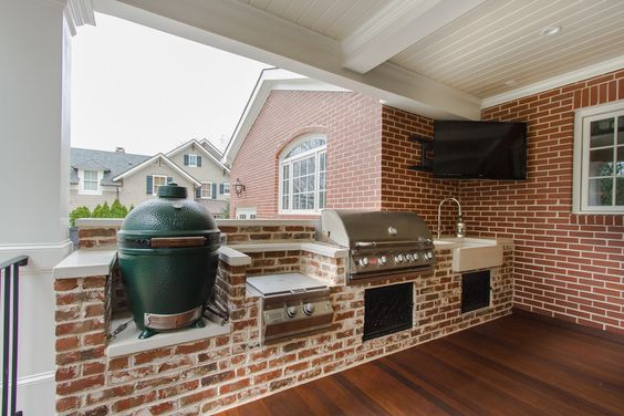 Chic deep fat fryer in Porch Traditional with Brick Facade next to Outdoor…