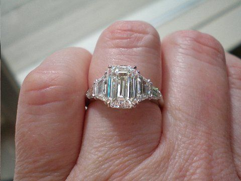 five ring with 3 24ct emerald cut center with 90ctw
