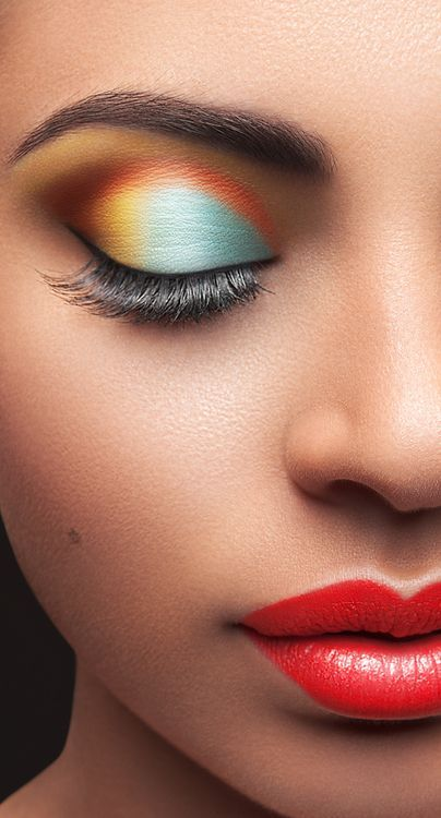Multicolor eyeshadow with red lips.