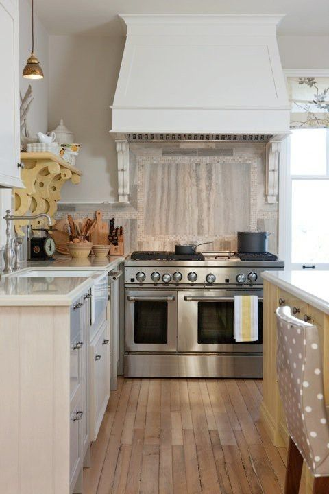 Love farm house kitchens! Want a little more color but I would live that stove and 2 ovens. Mmmm all the yummy food I could make. :p