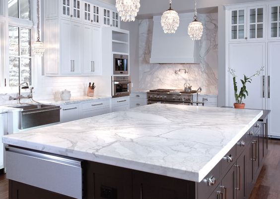 A large slab of white marble can really set the tone for the entire room and this piece does that and more. It also extends to the back wall, which really makes this kitchen something to see.