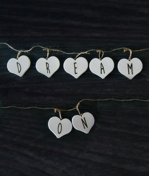 """Handmade wooden heart bunting featuring beautiful wood burnt lyrics from the Aerosmith song """"Dream On"""". Perfect pyrography for Steven Tyler fans!"""