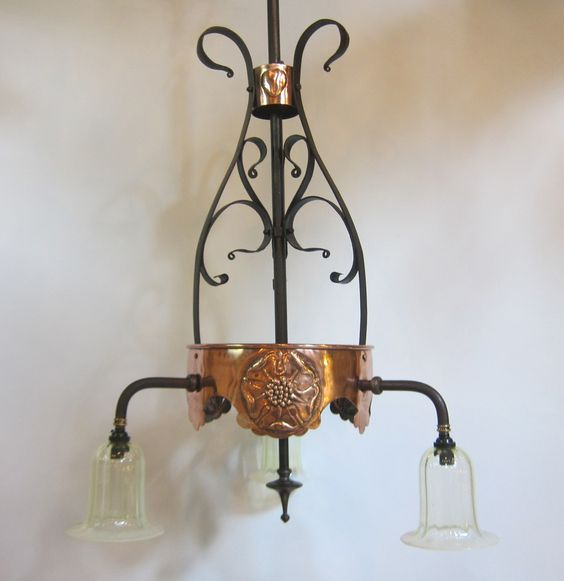 English three arm ceiling light in a wrought iron and copper finish.  www.antiquelightingcompany.com