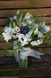 just-picked more natural look and designed hand-tied bouquets of freesias, veronica, lisianthus, chincherinchee, trachellium and blue eryngium thistle.