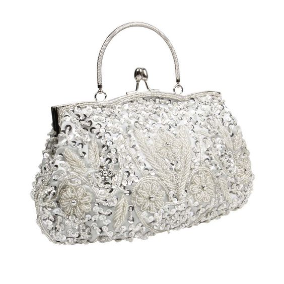 BMC Silver Beaded Sequin Design Metal Frame Kissing Lock Satin Clasp Interior Evening Clutch - Exuding Eloquence Collection. TURN HEADS with these GORGEOUS fashion clutch handbags from our Exuding Eloquence Collection. COMPACT, YET SPACIOUS this bag has the following dimensions 11 in (L) X 1.5 in (W) X 6.75 in (H). SECURE CLOSURE - features kissing lock clasp to keep your bag closed and items safe. ULTRA STYLISH EXTERIOR - these fashion clutches shine and are made up of beads, sequins and...