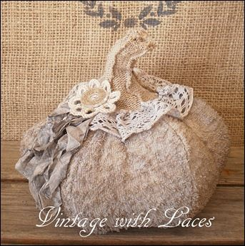 Upcycled Fabric Pumpkin by Vintage with Laces, love the stem on this one. (and the trim)