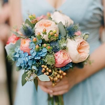 #SomethingBlue: Gorgeous Blue Accents | Globe thistle and hydrangeas are stunning blue accents to the peach flowers in this wedding bouquet. | SouthernLiving.com: