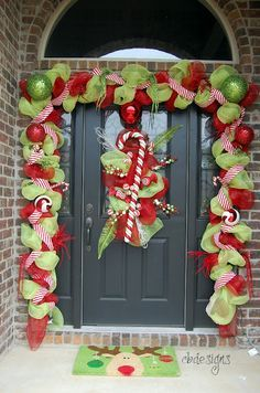 cute door decorations for Christmas with deco mesh.