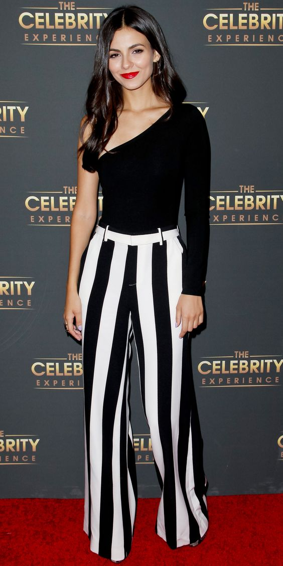 We can't get over Victoria Justice as the Celebrity Experience event at the Hilton Universal Hotel, wearing an asymmetrical sleeve top and striped wide leg trousers by alice + olivia by Stacey Bendet. The actress went sans accessories, opting to stun with just a bold red lip.
