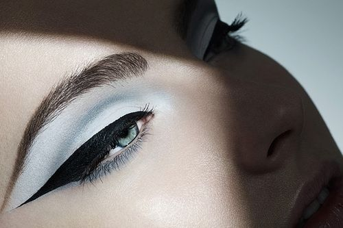 Extreme cat eye.  White frosted baby blue eye shadow in the crease with elongated black eye liner in dramatic cat eye.-- I just realized Left Eye essentially has this makeup on in the No Scrubs video.