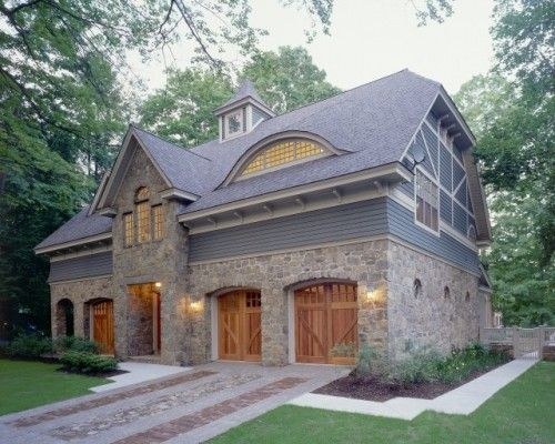 Unusual and lovely stone home with unique driveway roof for Barn shaped garage