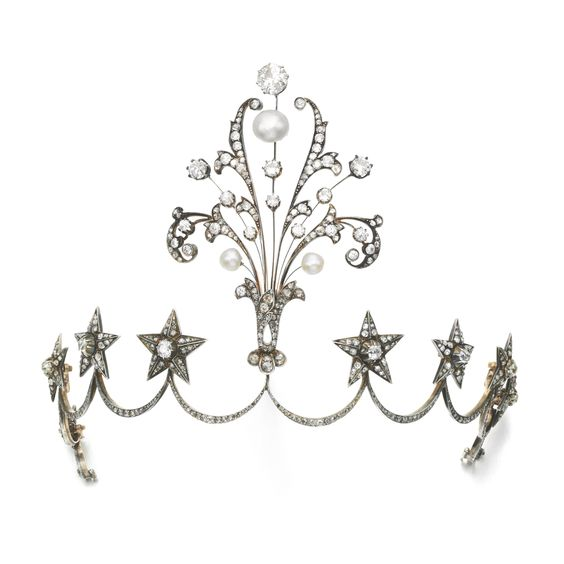 NATURAL PEARL AND DIAMOND TIARA/AIGRETTE, LATE 19TH CENTURY Centring on an aigrette of foliate scroll design, set with circular-cut and rose diamonds, accented with three pearls, to an inverted scroll tiara surmounted with eight five-pointed stars, fitted case stamped Guillot.