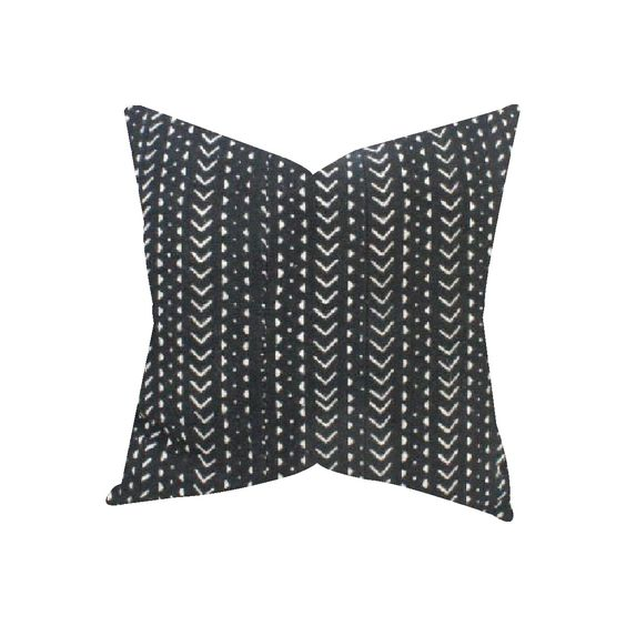 The pillow front is made from authentic African Mud Cloth, and the back is a natural, flax colored cotton.Please note that because the Mud Cloth is made by hand, there may be some imperfections...