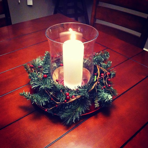 DIY Christmas Centerpiece:  Red charger plate, garland, cranberry garland, glass hurricane candle holder & candle